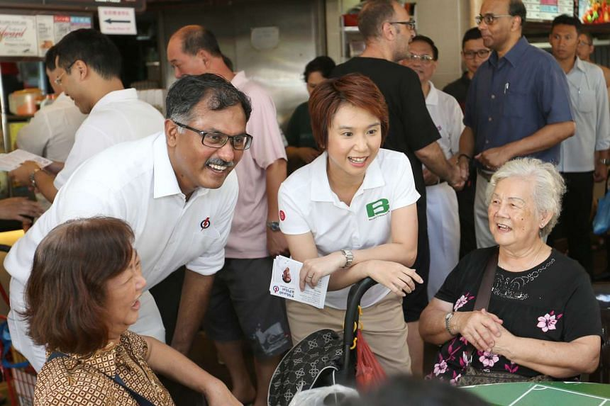 PAP's Murali Pillai (left) and South West District Mayor Low Yen Ling speaking to residents during a visit to the market at Block 154A, Bukit Batok West Ave 8.