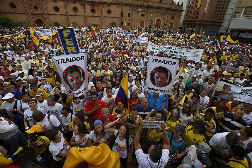 Thousands of demonstrators take part in a protest against the Revolutionary Armed Forces of Colombia (FARC) and President Juan Manuel Santos' government in Colombia, on April 2, 2016.
