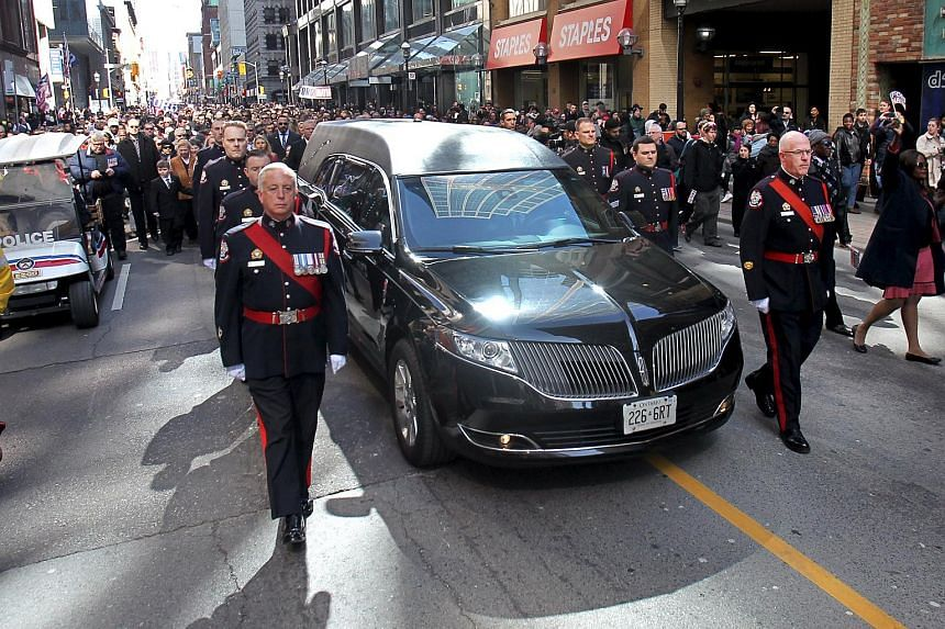 Procession with the casket carrying former mayor Rob Ford makes its way to St James Cathedral in Toronto, on March 30, 2016.