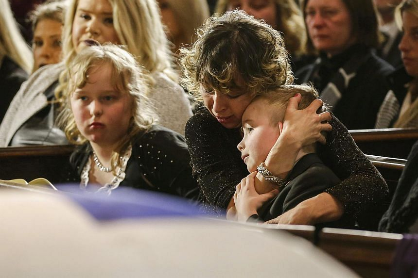 Widow Renata comforts her son Dougie, and daughter Stephanie at the funeral for former Toronto mayor Rob Ford, who died of cancer.
