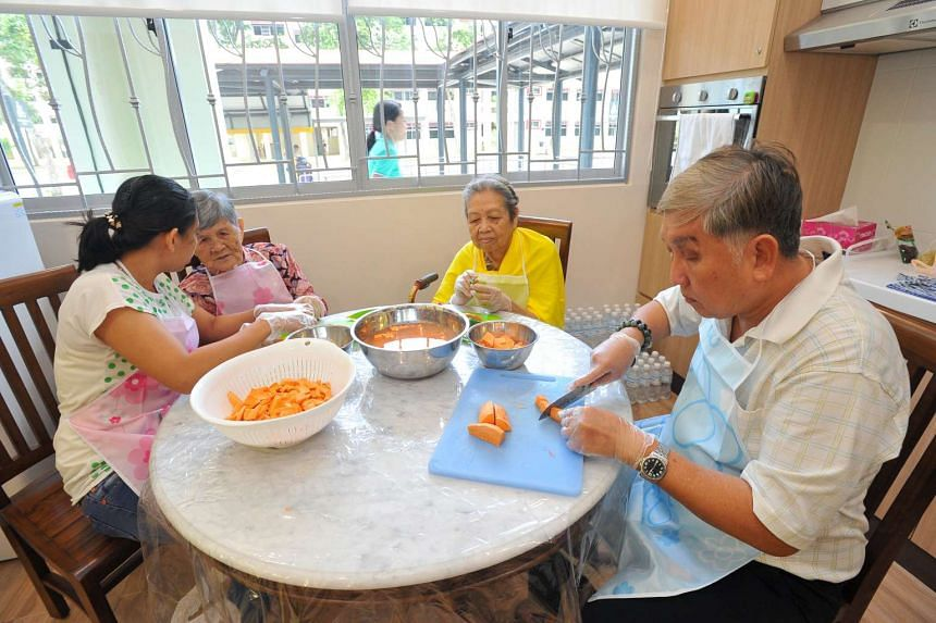 Seniors preparing food at a cooking session at PAP Community Foundation's Sparkle Care @ Changi Simei centre yesterday. A second senior care centre is due to open in the Yew Tee area by the end of the year.