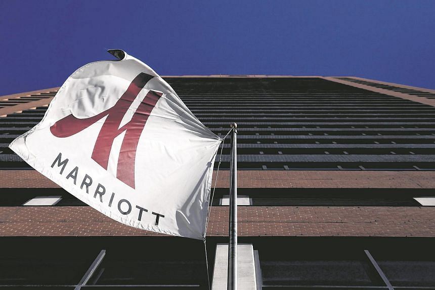 A Marriott flag hangs at the entrance of the New York Marriott Downtown hotel in Manhattan, New York in this Nov 16, 2015 file photo.