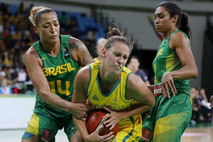 Basketball players for Brazil and Australia compete at an Olympics test event in January 2016.