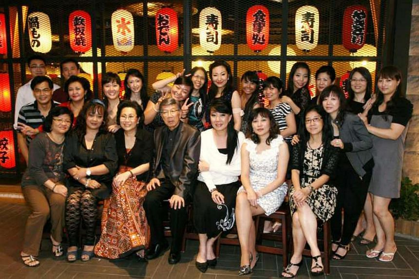 Mr Tham with his Exim Arts staff at a dinner event. He grew the home accessory company, which dealt in arts and crafts and knick-knacks, from one outlet to more than 10 and sold it off a couple of years ago.