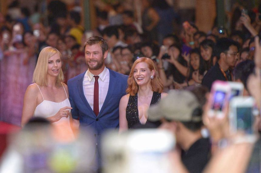 Hollywood stars (from left) Charlize Theron, Chris Hemsworth and Jessica Chastain in front of the cameras at the red carpet premiere of The Huntsman: Winter's War at Universal Studios Singapore.