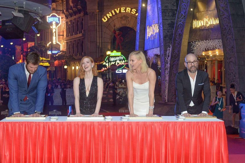 (From left) Chris Hemsworth, Jessica Chastain, Charlize Theron and director Cedric Nicolas-Troyan.
