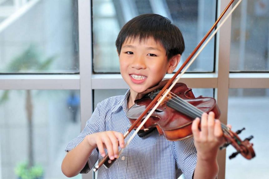 Violinist Samuel Tan is youngest winner of Italy's Postacchini Competition held in Fermo, Italy.