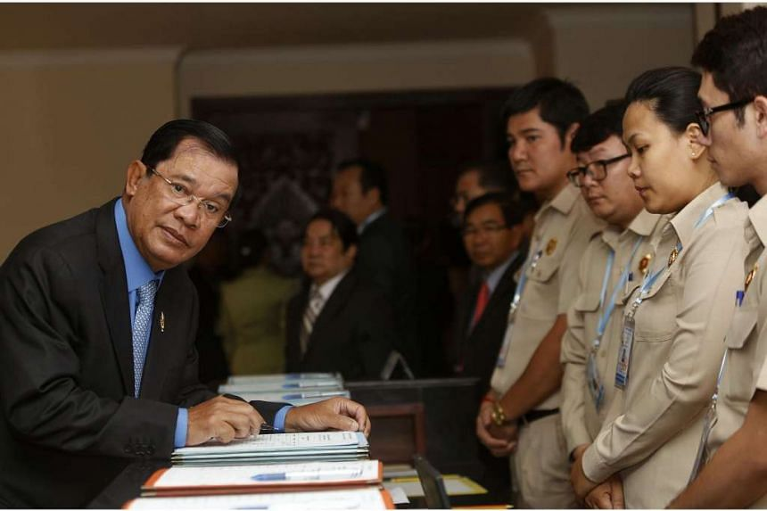 Cambodia's PM Hun Sen (left) arrives before Cambodia's Parliament session to vote on a rare shake up of his cabinet, at the National Assembly in Phnom Penh.