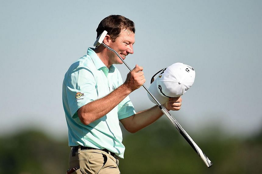 Jim Herman celebrates his victory on the 18th green during the final round of the Shell Houston Open, on April 3, 2016.