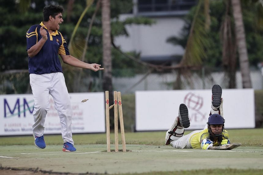 ACS (I)'s bowler and vice-captain Sidhant (left) celebrates as Victoria School's batsman and vice-captain Devanshu Bisht (right) suffers a run out in the B Division cricket final.