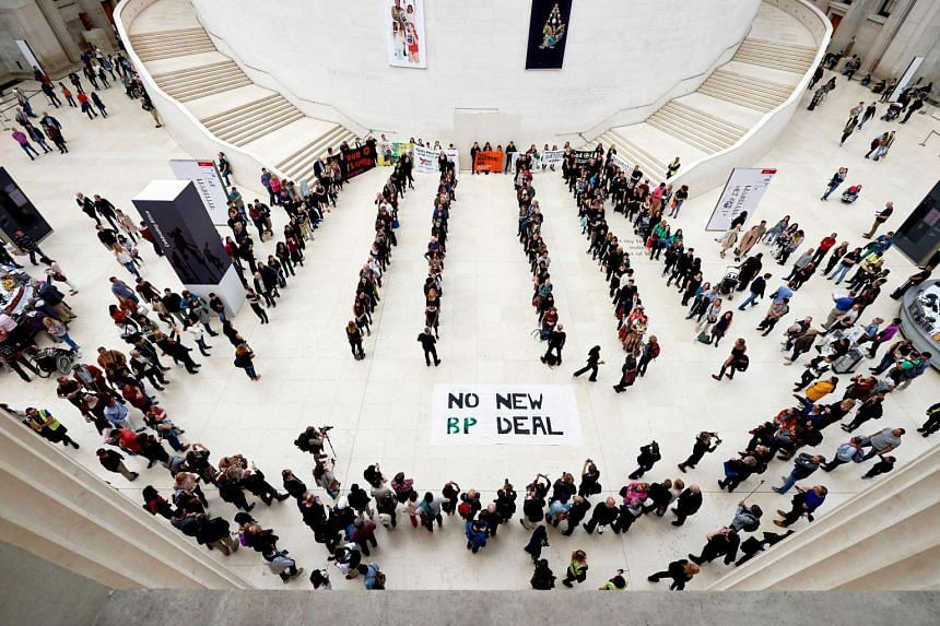 Protesters taking part in a flashmob performance, protesting against British Petroleum's (BP's) sponsorship of the British Museum in central London on Sept 13, 2015.