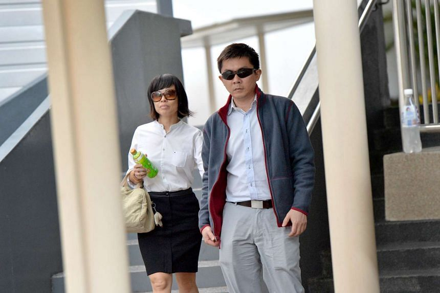 Tay Wee Kiat (left) and his wife Chia Yun Ling, who are facing maid abuse charges, at the State Court on April 4, 2016.