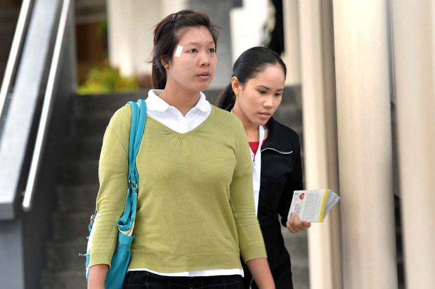 Ms Moe Moe Than (in green) is the prosecution's first witness during the trial today (April 4) at the State Court.