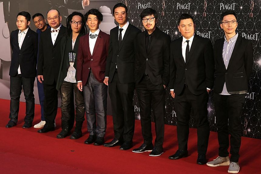 Left: The cast and crew of Ten Years on the red carpet at the Hong Kong Film Awards yesterday. Far left: A scene from the indie movie, which is an ominous depiction of what Hong Kong might be like in a decade.