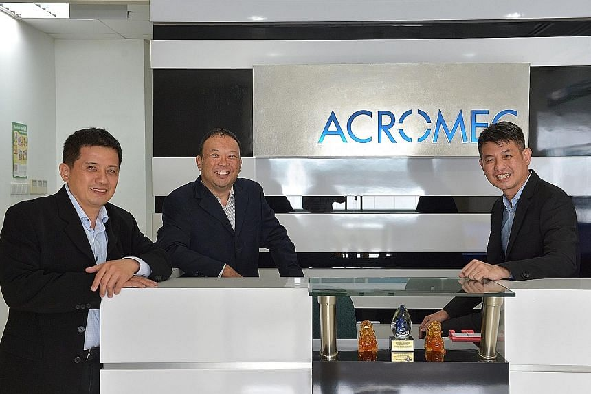 (From left) Acromec director Desmond Chew, Mr Lim, managing director, and Mr Goi, director. The engineering services provider specialises in designing and building facilities that require controlled environments, such as clean rooms and laboratories,