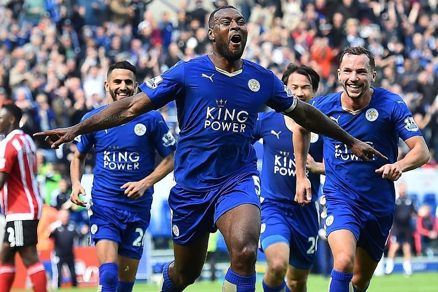 Leicester captain Wes Morgan (front) celebrating his goal. He claimed he had been ill on Saturday but was determined to play yesterday's game.