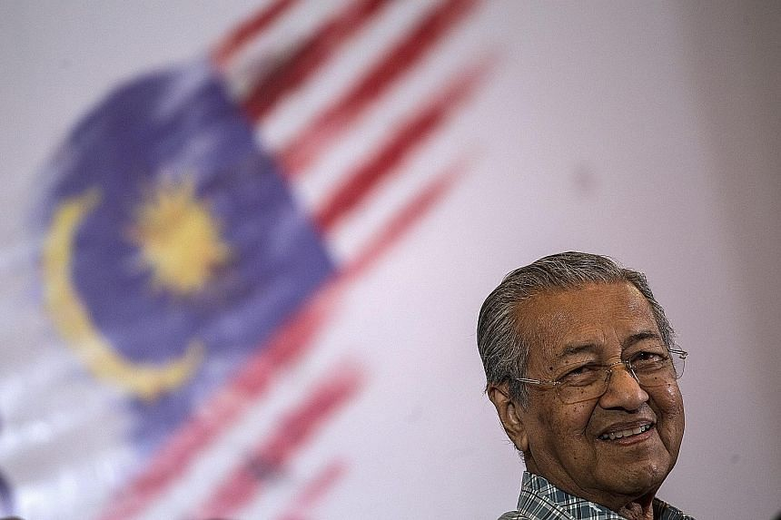 Dr Mahathir at an event of the Save Malaysia movement in Shah Alam, Selangor, last month. He acknowledges that the opposition is not very strong to helm the country and has problems. His key aim in working with it is to push Mr Najib out of office by