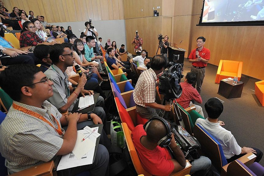 Minister in the Prime Minister's Office Chan Chun Sing at a dialogue with more than 200 young people during his visit to Geylang Serai ward in Marine Parade GRC yesterday. He said that how cohesive Singapore stays depends on whether people think in t