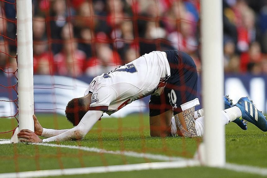 Tottenham midfielder Dele Alli reacts after spurning a chance to score at Anfield. His manager has urged players to maintain belief that they can prevail in their pursuit of the title.