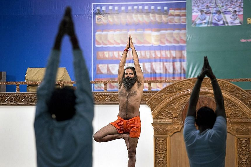 Mr Ramdev teaching yoga in Haridwar, India, on Feb 26. He is is the leader of what brand specialists call the Baba Cool Movement, where spiritual men market health products based on ayurveda.