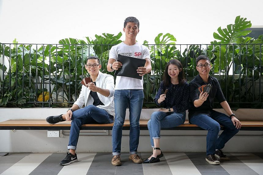 (From left) Mr Chiang, Mr Ee, Ms Leong and Mr Leong had to learn how to make leather goods from scratch. Their efforts helped them chalk up a profit of $6,000 in six months.