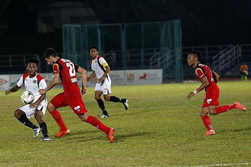 Balestier Khalsa's Smajovic Sadin (No. 27) going on the attack against Home United in their S-League football match at Toa Payoh Stadium last night. Ken Ilso's penalty, his third goal of the season, gave Home a 1-0 win over the second-last Tigers. At