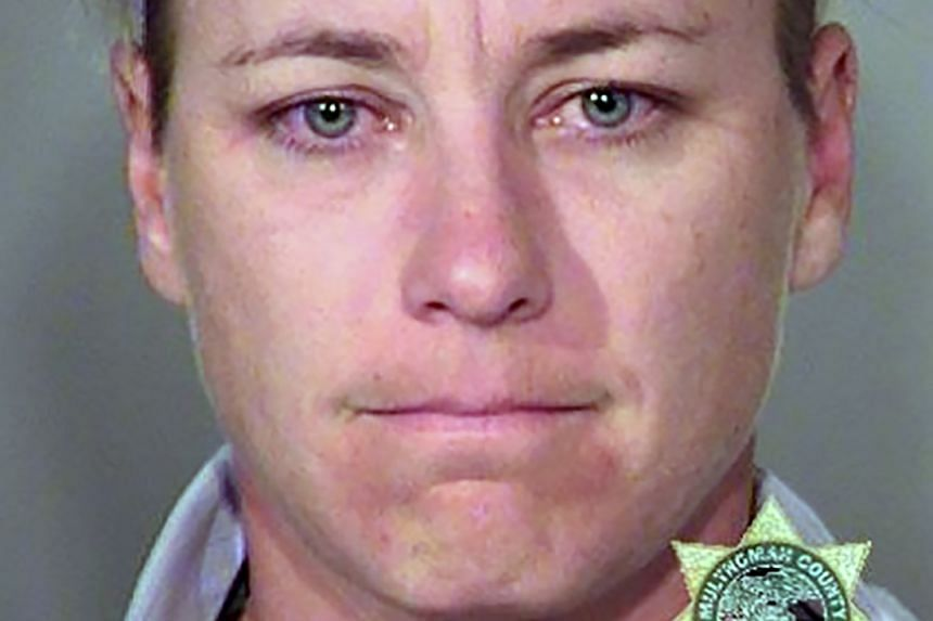 Retired US woman's football star Abby Wambach is seen in an undated booking photo released by the Multnomah County Sheriff's Office in Portland, Oregon.