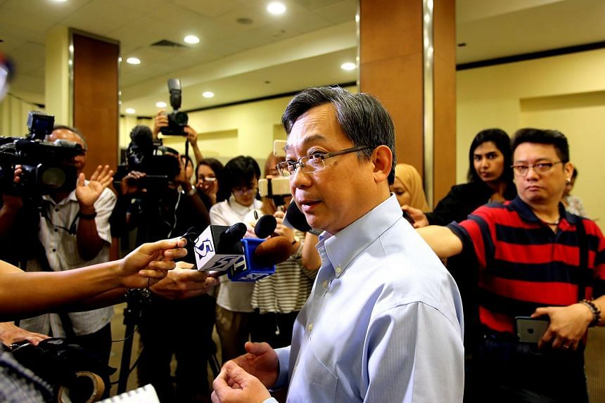 Health Minister Gan Kim Yong speaking to reporters at the Singapore General Hospital (SGH) on 6 October 2015.