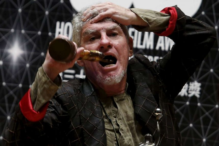 Hong Kong-based Australian cinematographer Christopher Doyle celebrates after winning the Best Cinematography award for movie Port of Call.