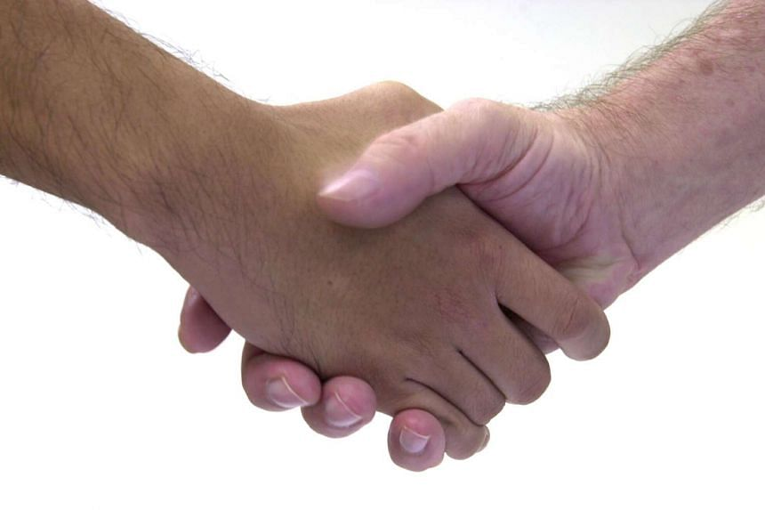 Posed photo of a handshake.