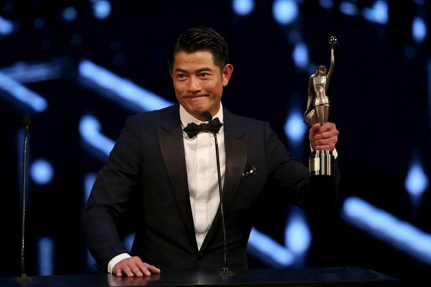 Aaron Kwok celebrates after winning the Best Actor award for his role in movie Port of Call at the Hong Kong Film Awards on Sunday.