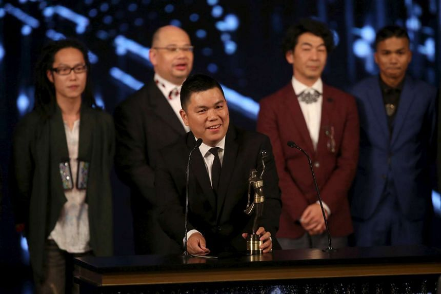 Ten Years executive producer Andrew Choi (centre) accepts the award for Best Film at the Hong Kong Film Awards.