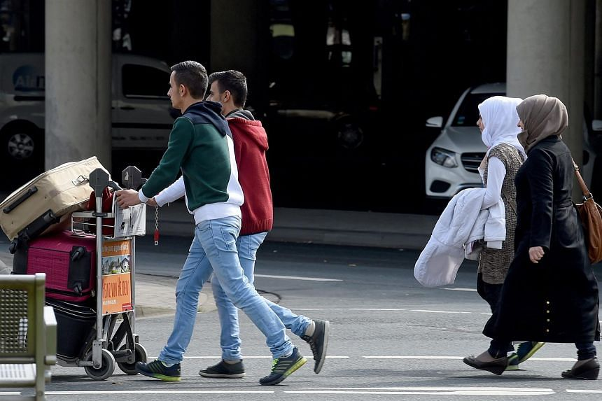 Syrian refugees arrive at Hanover airport in Hanover, Germany, on April 4, 2016, under the EU-Turkey migrant pact.