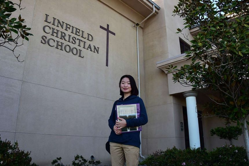 "Chinese student Hailun ""Helen"" Zhou poses on campus at Linfield Christian School, in California, on March 23, 2016."
