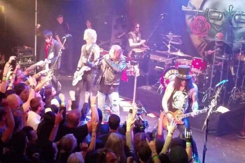Guns N' Roses playing at the Troubadour in West Hollywood. They performed for the first time together in public after more than two decades.