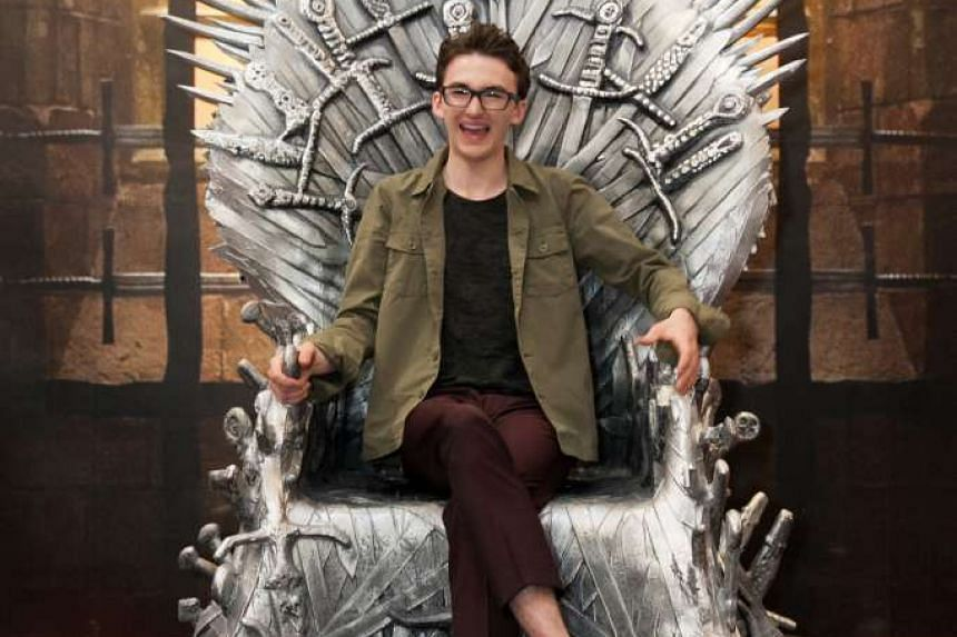 English actor Isaac Hempstead Wright taking wefie with fans at the interactive event at Ion Orchard and (above) sitting on the life-sized replica of the iconic Iron Throne.