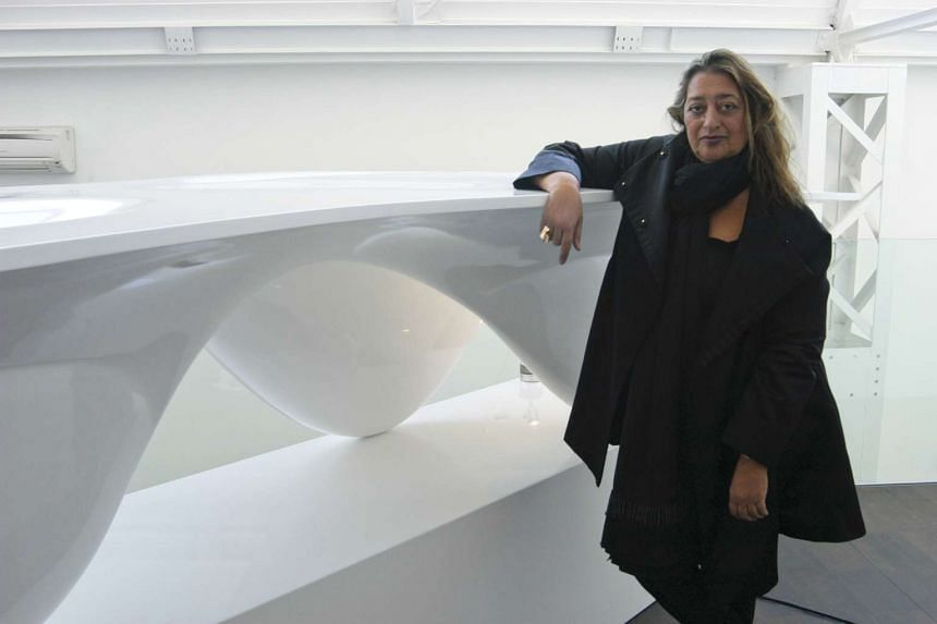 Zaha Hadid with the 'Aqua' table she designed in 2005. She was the first woman to win the Pritzker Prize, architecture's top honour, in 2004.