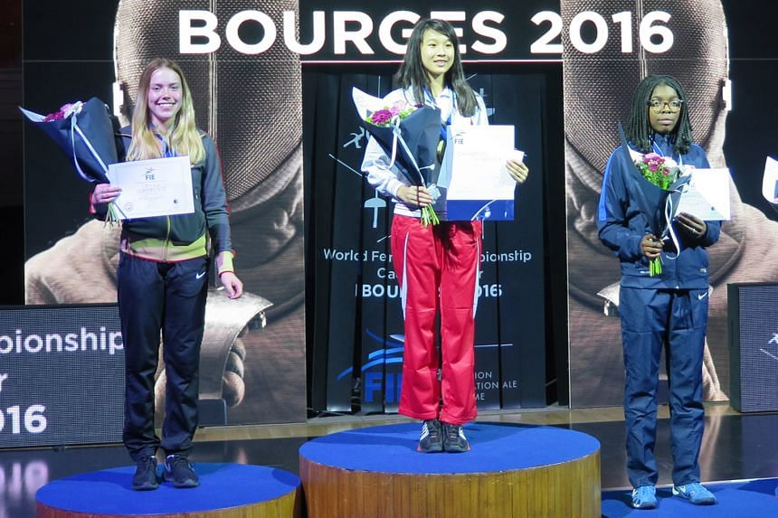 Fencer Lau Ywen made history for Singapore when she was crowned world sabre cadet champion in Bourges, France. The 16-year-old recovered from an early deficit to defeat Germany's Larissa Eifler (left).