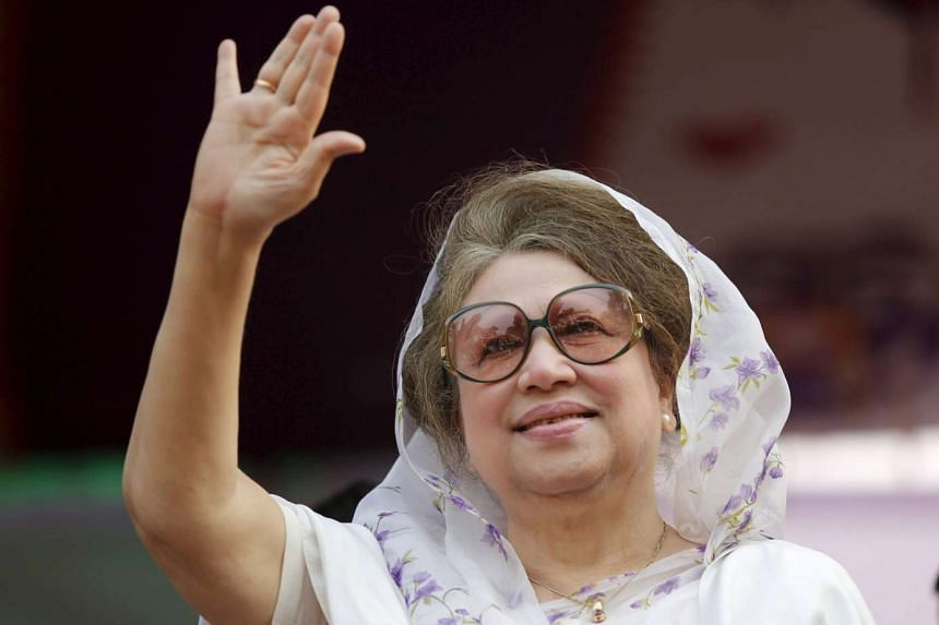 Former Bangladeshi prime minister Khaleda Zia, waving to activists as she arrives for a rally in Dhaka, on Jan 20, 2014.