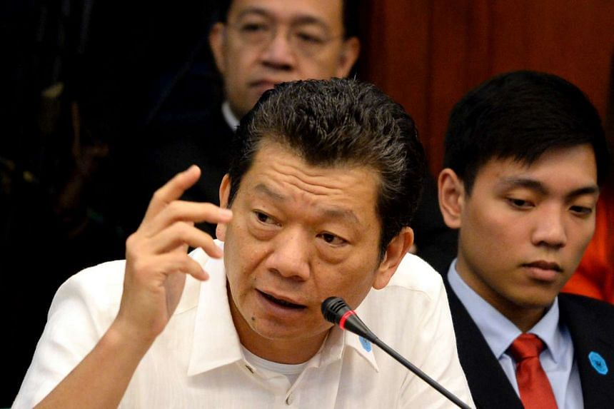 Casino junket operator Kim Wong gestures as he gives a statement during a senate hearing in Manila on April 5, 2016.