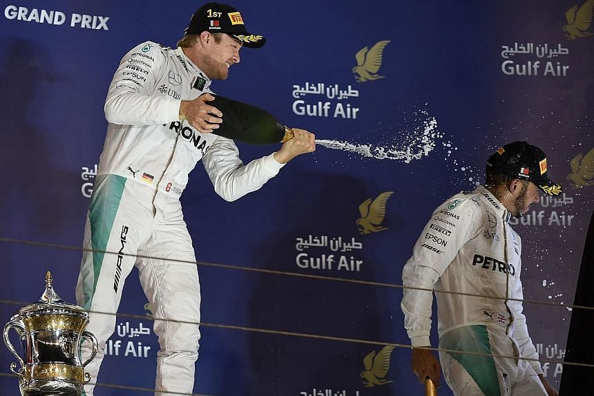 A triumphant Nico Rosberg spraying champagne on team-mate Lewis Hamilton, who finished third behind Ferrari's Kimi Raikkonen in Sunday's Bahrain Grand Prix. Despite a five-race drought, the Briton is confident he can sort out his start problems soon