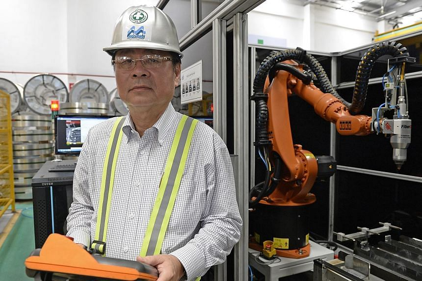 Singapore's Purchasing Managers' Index - an early indicator of manufacturing activity - was at 49.4 last month, up slightly from February's 48.5 reading. Most factory bosses, such as M Metal managing director John Kong (above), hesitated to say that