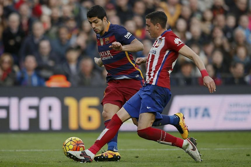 Barcelona's Luis Suarez and Atletico Madrid's Jose Maria Gimenez in action during a match.