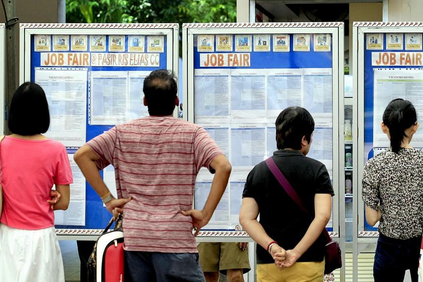 Visitors looking at the job listings displayed on boards at a recruitment drive by Project Success, on May 3, 2014.