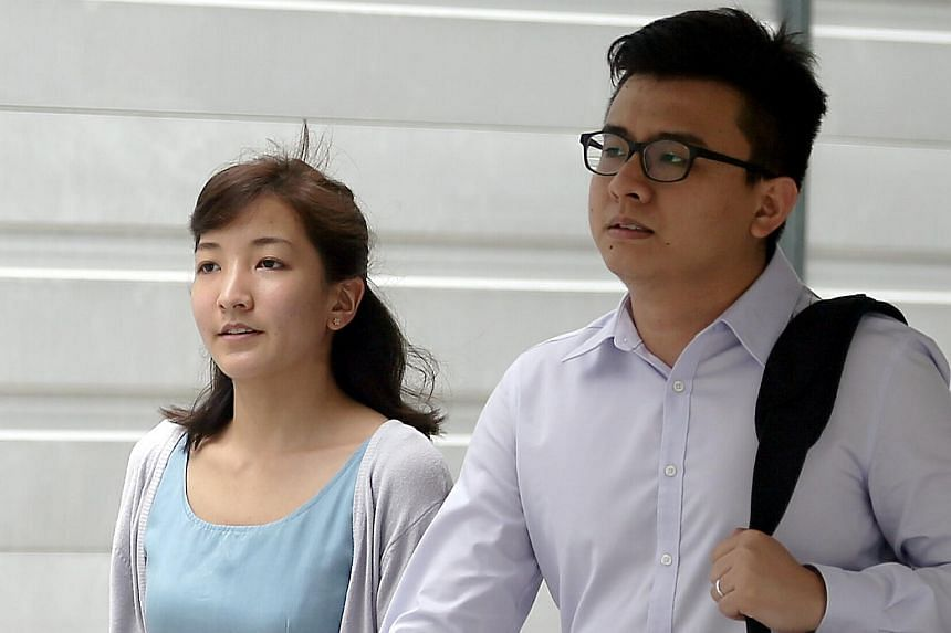 Yang Kaiheng (right) and his wife Ai Takagi leaving the State Courts on Tuesday.