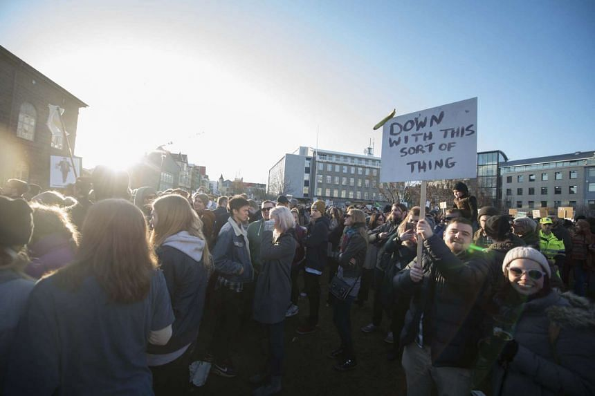 People protest against Iceland's Prime Minister Sigmundur David Gunnlaugsson outside Parliament in Reykjavik on April 4, 2016.