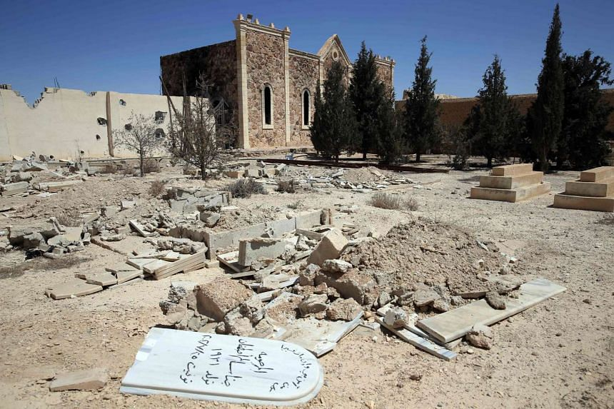 Christian graves destroyed by ISIS at the devastated monastery of Syriac Catholic Saint Elian in al-Qaryatain shown on Monday, after Syrian troops regained control of the town.
