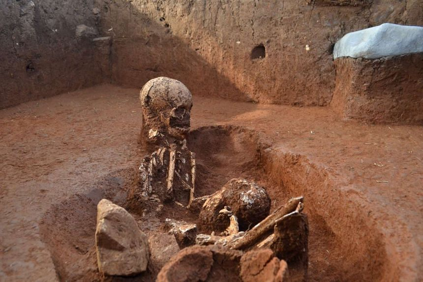 Human remains  found at an ancient burial ground at the Plain of Jars in Laos are shown in an Australian National University photo released on Monday.