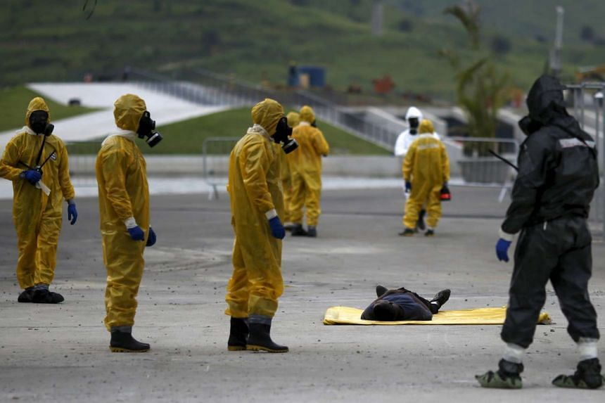 Brazilian Army soldiers take part in a simulation of decontamination of multiple victims against Chemical, Biological, Radiological and Nuclear attacks ahead of the Rio 2016 Olympics.