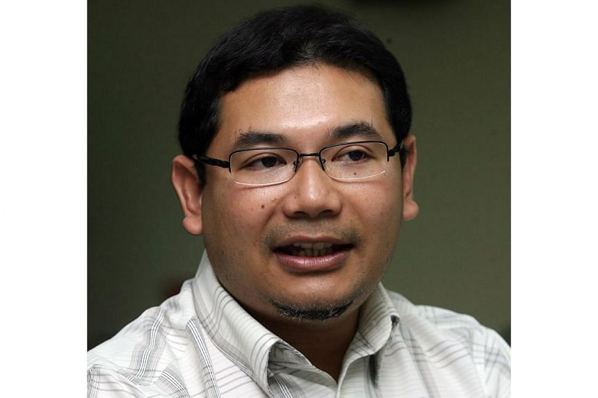 Mr Rafizi Ramli was taken away in front of the Parliament gate in Kuala Lumpur to the federal police headquarters in Bukit Aman on April 5, 2016.